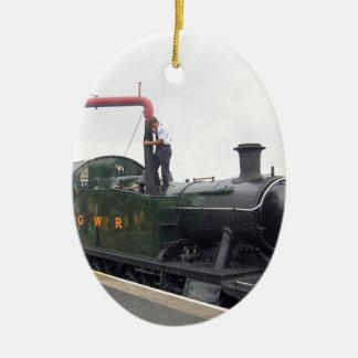 Riego de una locomotora de vapor adorno ovalado de cerámica