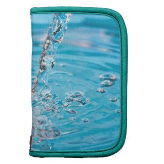 Riegue fluir en una piscina planificadores