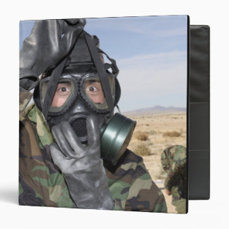 Rifleman puts on his gas mask 3 ring binder