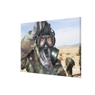 Rifleman puts on his gas mask canvas print