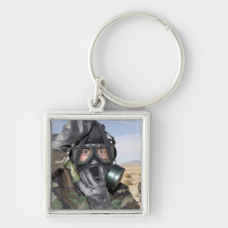Rifleman puts on his gas mask key chains