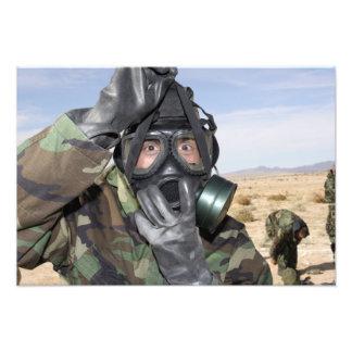 Rifleman puts on his gas mask photograph