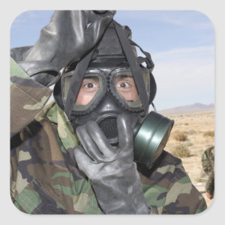 Rifleman puts on his gas mask square stickers