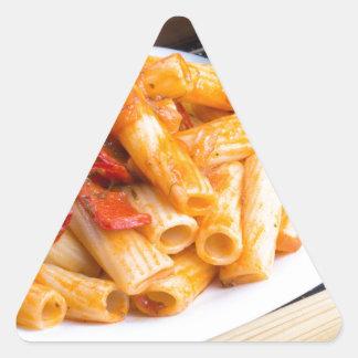 Rigatoni pasta, seasoned with pepper and arugula triangle sticker