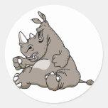 Rinoceronte duro del dibujo animado etiquetas redondas