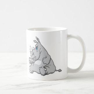 rinoceronte que se sienta obstinado taza de café