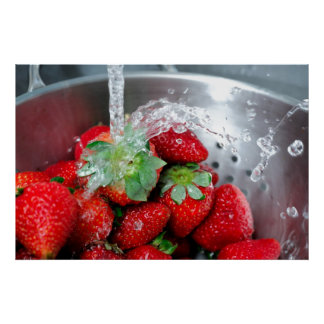 Rinsing Strawberry With Water Posters