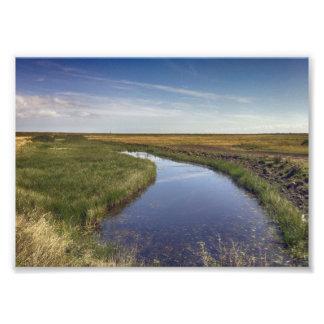 Río de la bobina por la costa fotografías