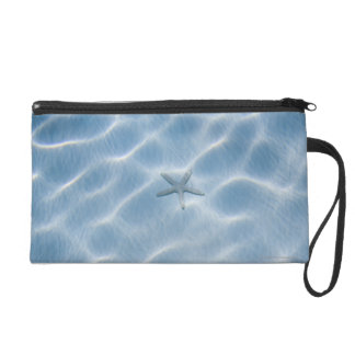 Rippled blue water with starfish wristlet
