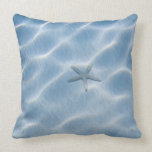 Rippled blue water with starfish pillow
