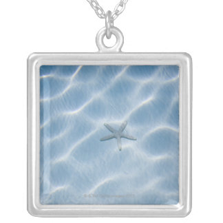 Rippled blue water with starfish silver plated necklace