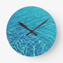 Ripples and wave patterns on crystal clear water round clock