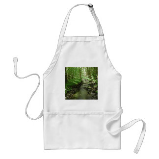 River flowing through woodland. adult apron