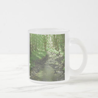River flowing through woodland. frosted glass coffee mug