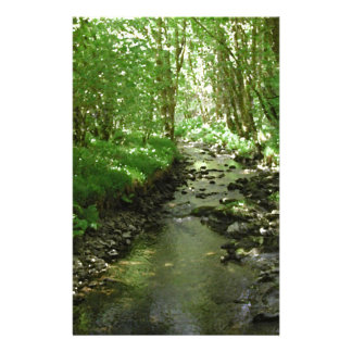 River flowing through woodland. stationery design