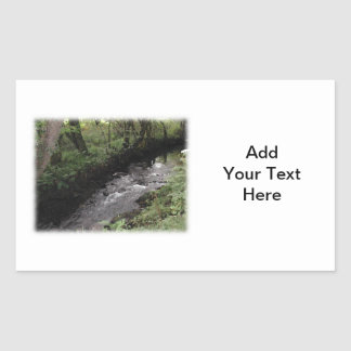 River flowing through woodland. rectangular sticker