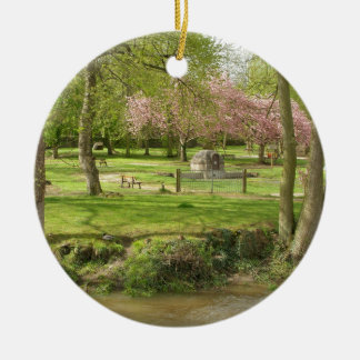 River front pink flowers of prunus in a park ceramic ornament