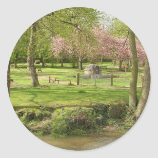 River front pink flowers of prunus in a park classic round sticker