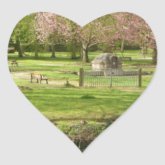 River front pink flowers of prunus in a park heart sticker