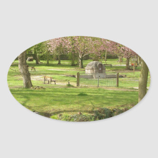 River front pink flowers of prunus in a park oval sticker