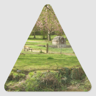 River front pink flowers of prunus in a park triangle sticker