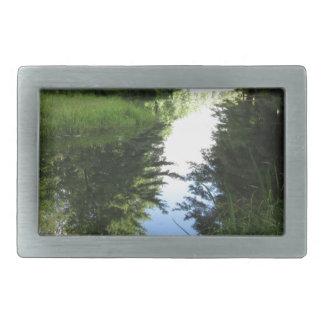 River runs through rectangular belt buckle