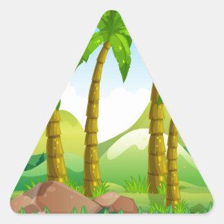 River scene with coconut trees triangle sticker