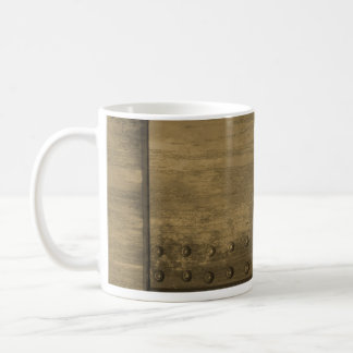 rivetted grungy gold metal plate coffee mug