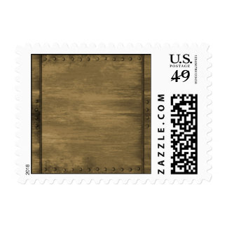 rivetted grungy gold metal plate postage stamps