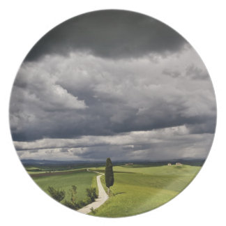 Road and storm clouds rural Tuscany region Party Plate