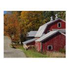 Road beside classic rural barn/farm in autumn, postcard
