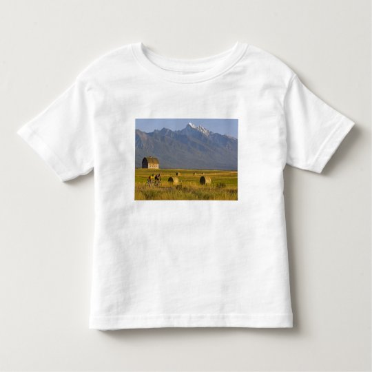 Road bicyclists race down back country road in toddler t-shirt