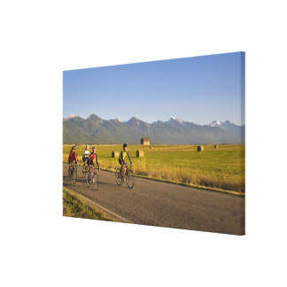 Road bicyclists ride down a back country road canvas print