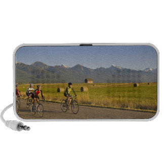 Road bicyclists ride down a back country road mini speaker