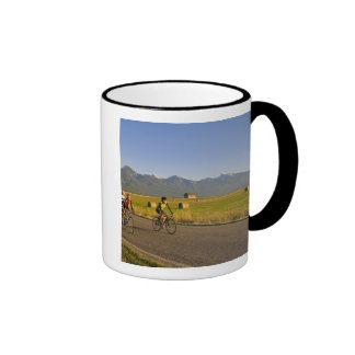 Road bicyclists ride down a back country road ringer coffee mug
