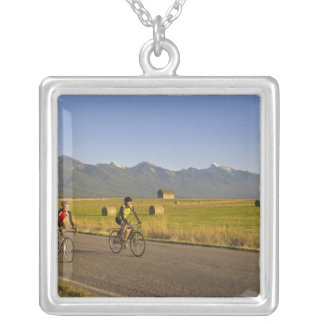 Road bicyclists ride down a back country road square pendant necklace
