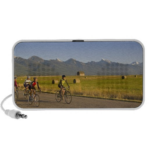 Road bicyclists ride down a back country road mini speakers