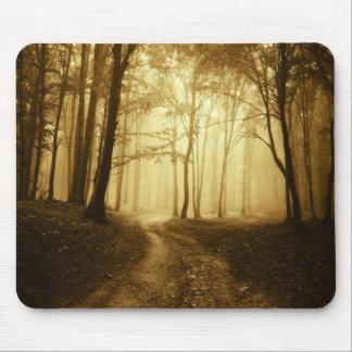 Road in a dark forest with fog mouse pad