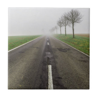 Road in fog leads to nothing ceramic tile