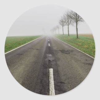 Road in fog leads to nothing classic round sticker