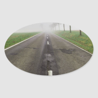 Road in fog leads to nothing oval sticker