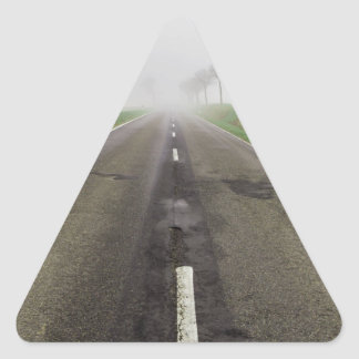 Road in fog leads to nothing triangle sticker