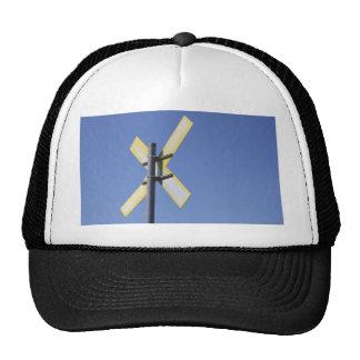 Road Sign against a blue sky Cap Trucker Hat