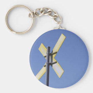 Road Sign against a blue sky Key Chain