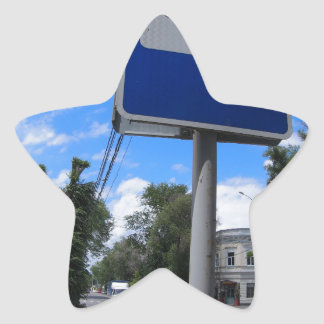 Road sign with a picture of a bus stop on a city s star sticker