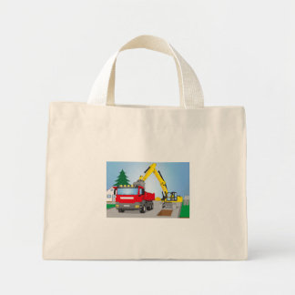 Road site with red truck and yellow excavator mini tote bag