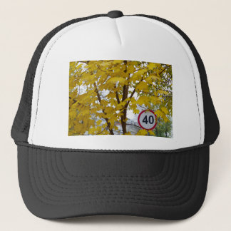 Road speed limit sign on a city street trucker hat