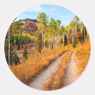 Road Through Autumn Colors Classic Round Sticker