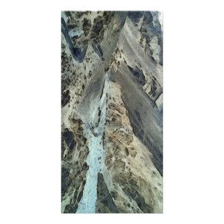 Road through mountainous terrain photo card