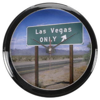 Roadside sign showing direction, California Aquarium Clock